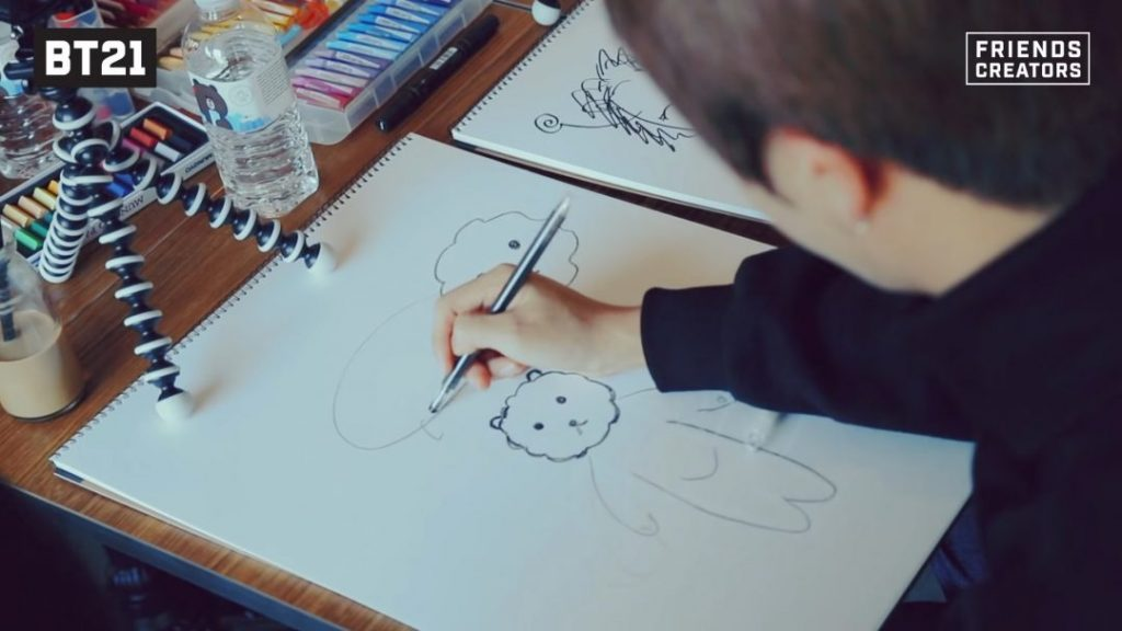 Джин в творческом порыве создает своего персонажа альпаку bt21 фото